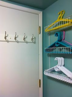 Use a paper towel holder for storing hangers in the laundry room buttons bows bling great hanger storage solutioingenieria Choice Image