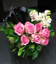 Deep purple Calla Lilies from New Zealand paired with lovey pink roses make a sweet and romantic NYC flower delivery for Valentine's Day