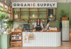 Organic Supply | sage, white tiles, warm timber