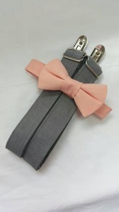 Peach Bow Tie with Grey Suspenders. Sizes Infant-Adult. Free Fabric Sample Available. Ring Bearer Suspenders, Grey Suspenders, Groomsmen Suspenders, Groomsmen Looks, Peach Bow Tie, Free Fabric Samples, Rings For Girls, Peach Colors, Wedding Stuff
