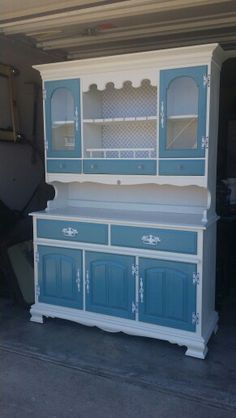Classy white and blue hutch Www.facebook.com/okiecharm