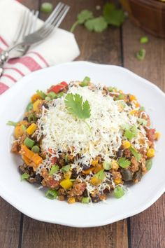 A one-dish, slow-cooker tex mex quinoa casserole. This casserole is bursting with fresh and healthy flavors with some good spice. This dish is vegetarian, but chicken, ground beef, or ground turkey can easily be added in.