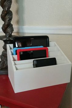 Great Family sized charging station. Has the ability to hold at least 3 tablets, and 4 phones. Room underneath for a power strip to hide all
