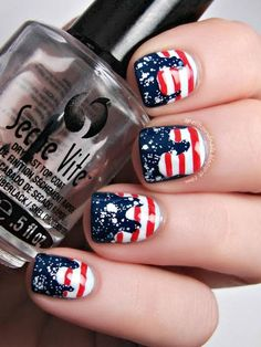 This drip design bySpellbound Nailsis a funky take on flag-inspired nails. Start with a navy blue base and a glitter topcoat. Then freehand-paint the white and red stripes using a nail art brush!