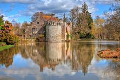 Scotney Castle encompasses the ruins of a medieval, moated manor house, Scotney Old Castle, which is on an island on a small lake. The newer castle was built 1835 and 1843. Catholic Recusant owner Thomas Darrell hid Jesuit Father Richard Blount, S.J. in the castle while he administered to Roman Catholics from 1591 to 1598. Catholicism was then illegal in England, and during the second raid by authorities to arrest the Father he fled over a wall into the moat and escaped.
