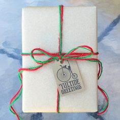 "Handmade Christmas gift tags -- kraft with penny farthing bicycle and ""yuletide greetings"" on one side, blank on reverse."
