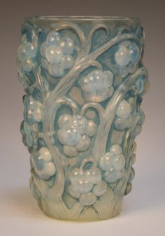 A Lalique opalescent and blue stained Raisins pattern cylindrical vase, 1930s, stencil mark 'R. Lalique France' to base, height approx 15.5cm.