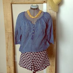 """Be Back Soon! No Shipping 12/11-15. Bundle 3 for $15, all items under $8 Nine West Chambray Boho Top with Embroidered Design. Size S measures 23"""" long, 18"""" sleeve from neck. Very thin material. There is a small hole on front caused by button on jeans. Nine West Tops"""