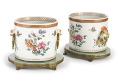 A pair of Chinese Export porcelain famille rose jardinières and mounted ormolu stands<br>the porcelain circa 1740 | Lot | Sotheby's