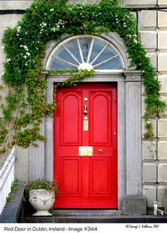 A red front door in Dublin, Ireland. Learn the history of red doors, including their hidden meanings, on Debbiedoo!