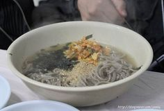 It is called 'KotDeungChiGi (Slaping nose noodles)' because the noodles may slap your nose when you eat it because of a chewy texture.