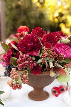 Peony and blackberry wedding centerpiece | Brides.com