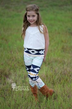 Create Kids Couture - Blaycie's Skinny Pants PDF Pattern. Blaycie is made from woven fabrics and has optional pockets, piping, and center crease details.