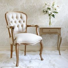 Chateauneuf Armchair | When we visualise a typically French chair, this is it! This armchair reminds us of vintage French dressmakers mannequins - with its beautiful fabric cover, wooden frame and beautiful form. Upholstered with a natural linen cotton material with a simple rustic wood, this chair would sit perfectly in a French shabby chic bedroom or stylishly neutral lounge.