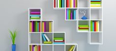 White bookshelf with a colorful books.