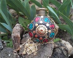 Copy pastes the link below to watch the video: https://youtu.be/gcS15X7G9MM Ethnic   Perfume Bottle Necklace This beautiful perfume bottle enamel necklace is made of brass with beaded frieze patterns, gadroons and a central gold flower with little round all over. The chain is in brass. Colors are red, green, black and gold. The originality and style of the designer will give you a very unique and stylish look for all your days out. The metal is free from any allergy. Bottle hei...