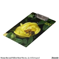 Honey Bee and Yellow Rose Two sided Clipboard. The back side shows the bee going into the rose.   This is an add on to a set of mouse pads, coffee cup, desk organizer and name plate.