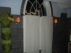 Castle room, Knight helmets , real tourches and a castle bunkbed will take you back to medival time in this castle theme room,, Flickering tourches and luminated knight helmet add a warm glow to this medival space., Boys Rooms Design