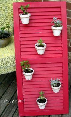 Using reclaimed shutter as plant holder. Love the red.