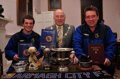 Ryan McGerrigan, John Hynds and Mayor Jim Speers celebrating Armagh City's general amazingness.