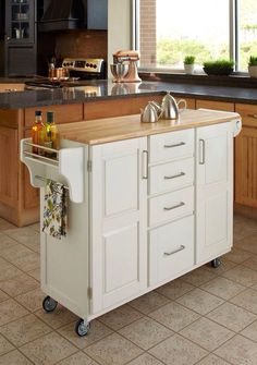 Love the size of this island! Cabinets, counter, towel rack, on wheels, I could go on....