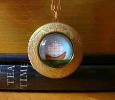 Ship Locket Nautical jewelry Sailboat Necklace brass locket gold locket Boho jewelry Wearable Art vintage locket nautical necklace. $35.00, via Etsy.