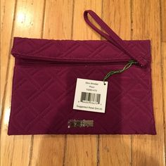 "Vera Bradley Slim Wristlet Brand new with tags slim wristlet in Plum with a front zip pocket, 3 card slots in the inside and 6"" wrist strap. Vera Bradley Bags Clutches & Wristlets"