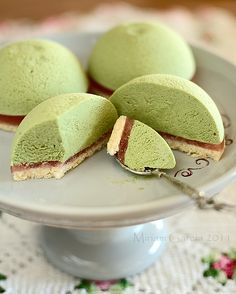 Matcha Mousse Cakes. Here's a recipe for adorable teatime treats! The fluffy matcha mousse sits atop a layer of strawberry jam and cake. #matcha #dessert