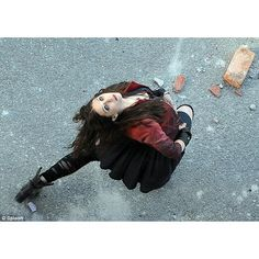 Elizabeth Olsen's Scarlet Witch shoots action packed Avengers scenes ❤ liked on Polyvore featuring marvel, avengers, elizabeth olsen and people