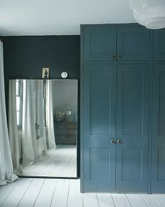 Bedroom redec- build wardrobes like these? Walls will be same blue/black..