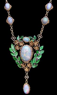 This is not contemporary - image from a gallery of vintage and/or antique objects. JOHN PAUL COOPER (1869-1933) (Attrib.)  An Arts & Crafts gold necklace. The central opal pendant set within a mount of green enamelled leaves suspended from a chain with cabochon opals and green enamel and flower links.