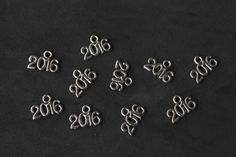 GRADUATION/WEDDING FAVORS-2016 CHARMS-This is a set of 20 silver tone, tiny 2016 charms.  Great for graduation day, weddings, anniversary parties or adding to hand made cards and gift tags.  CONVO ME FOR LARGER QUANTITIES.  Size is approx 9mm x 13mm.