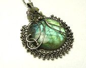 Reserved  -  Silver wire wrapped pendant with labradorite, green, woodland, wirework