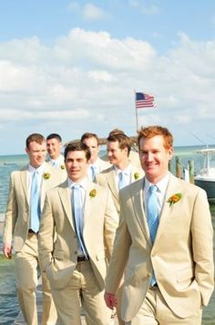 neutral tone groomsmen maybe with high waters and sperry's?