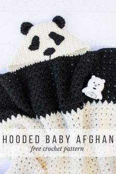 """This free crochet hooded baby afghan pattern will give your favorite child the chance to feel like a cozy little panda. Make one for the new baby to grow into and another for an older sibling to enjoy right away! Customize the pattern to make a crochet koala or polar bear too! Made with Lion Brand Wool Ease Thick & Quick in """"Fisherman"""" and """"Black."""" Click for the free crochet pattern!"""