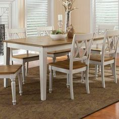 """Gather friends and family around this country-chic dining table, showcasing a 2-tone finish and block legs.  Product: Dining tableConstruction Material: WoodColor: Brown and creamFeatures:  Two-tone finishBlock legsDimensions: 30"""" H x 40"""" W x 74"""" D"""