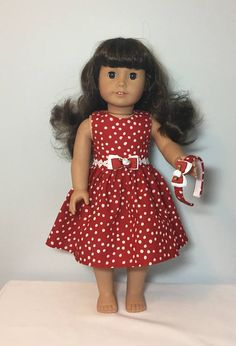 18 Doll Dress. Fits American Girl Doll. AG Doll Dress. Your doll will love this red and white polka dot dress! The dress is made out of red and white polka dot cotton fabric. The waist is embellished with a beautiful flower lace trim and a red and white bow with a white rose. The