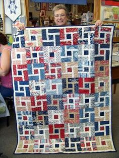 The Happy Scrappers met at the Attic Window Quilt Shop this past Saturday.  Not only did we have fun sharing and caring but we had some show-n-tell too!  Above, LeeAnne shows us a quilt that her cous