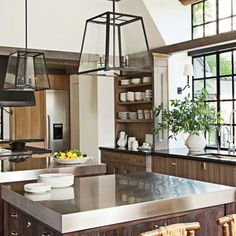 Stainless steel islands + carriagehouse pendants + window detail + design in Don and Rela Gleason's Napa Valley Home : Architectural Digest Classic Kitchen, Rustic Kitchen, New Kitchen, Kitchen Interior, Kitchen Dining, Kitchen Decor, Kitchen Ideas, Awesome Kitchen, Kitchen Sink