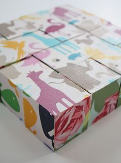 Cute fabric covered blocks!  I love the prints here, but when I make it, I'm probably obligated to use a more boyish (or at least gender neutral) selection of fabrics.