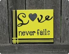 """Love never fails"" canvas art"
