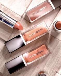 nude lip glosses and lipsticks that leave your lips feeling buttery, nourished, and sultry. head to nudeenvie.com to get yours!