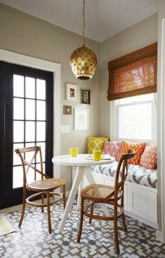 love the banquette - black door, the fabrics, the gold pendant