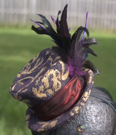 Fetching Purple and Gold Tapestry Mini Top Hat with Wine Color Silk Band with Assorted Feather Accent $37.00