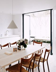 A clever & stylish design for this compact two-story house, built on a tiny narrow block in...