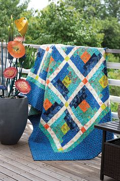 The Log Cabin block is a perennial favorite. This queen-size quilt by John Kubiniec is easy enough for a beginner and makes a powerful statement.