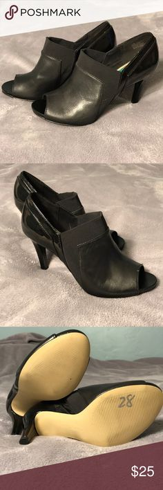 Black ankle heels Never Worn! Anne Klein black ankle heels. Peep toe. Light marks on the bottom from trying on. Small indent on left heel (not noticeable when wearing). Small marking from removal of tag in inner sole. Anne Klein Shoes Ankle Boots & Booties