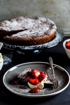 Flourless chocolate torte with Macerated strawberries. #Cake #Baking