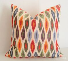"F. Schumacher / Sunara Ikat Lumbar Pillow Cover / 18"" x 18"" / Spice / Decorative Pillow / Designer Fabric / Same fabric front & back. $51.00, via Etsy."
