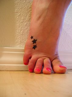 star tattoos, star foot tattoos and tattoo designs. Toe Ring Tattoos, Star Foot Tattoos, Cute Foot Tattoos, Foot Tattoos For Women, Love Tattoos, Future Tattoos, 3 Stars Tattoo, Neck Tattoos, Tattoos Skull